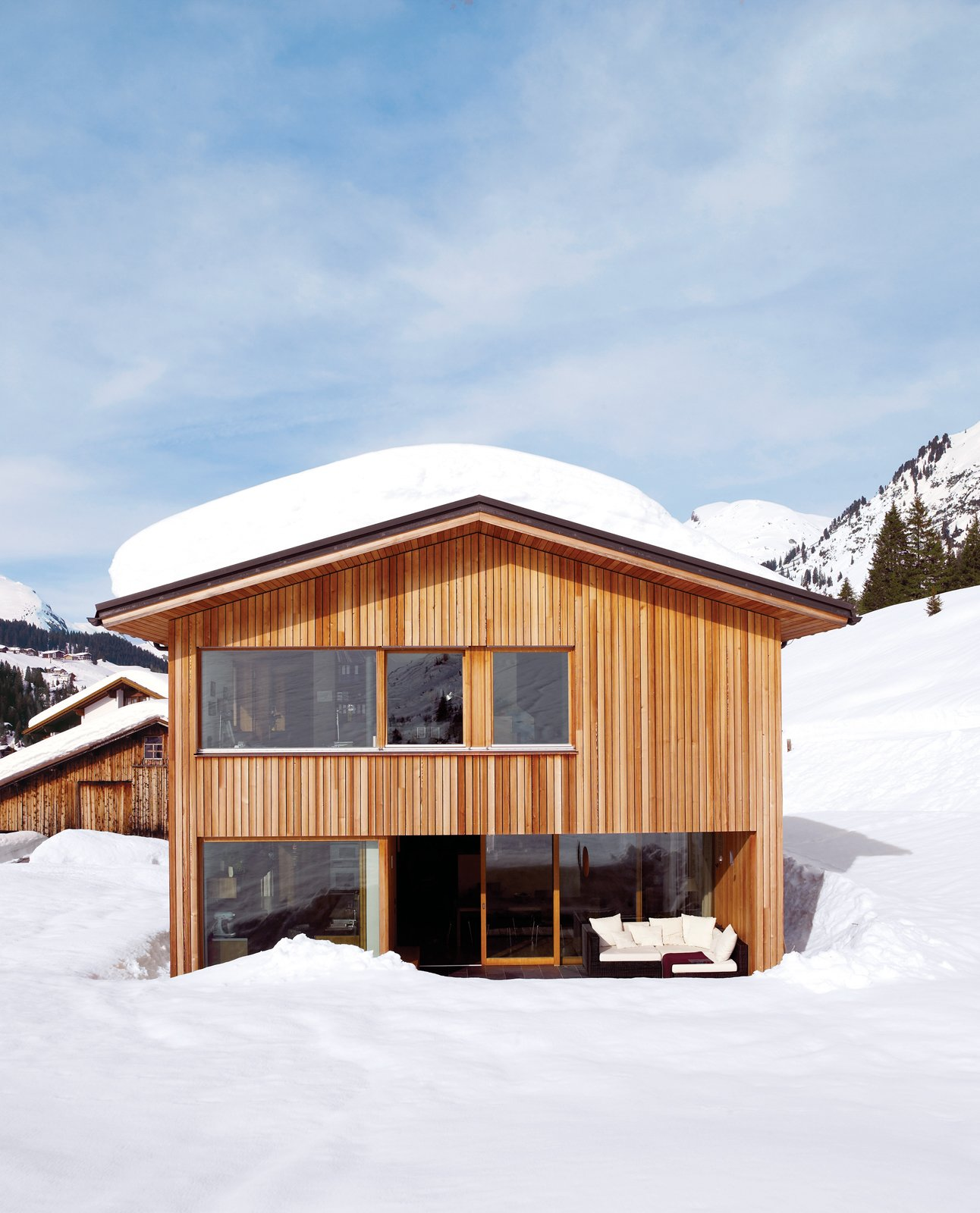 Exterior, Cabin Building Type, Wood Siding Material, Gable RoofLine, and House Building Type The solar panels on the roof often get covered in a heavy layer of snow, but with periodic clearing, they are as effective during the sunny days of winter as they are during fairer weather.  Photo 7 of 8 in Snow Proofed Hillside Family Home in Austria