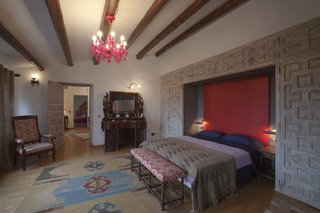La Bodega has six guest bedrooms furnished with pieces from the owner's personal antique collection.