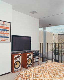 An Alexander Girard poster for the Herman Miller Textile & Objects Shop in the master bedroom is original to the house.