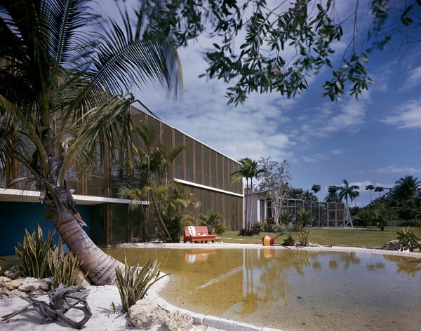 The Birdcage House by Igor Polevitzky in Biscayne Island, with its massive screened facade, was directly inspired by Marcel Breuer's experiments in regional modernism in Massachusetts.  Photo 11 of 13 in Miami Modern Metropolis