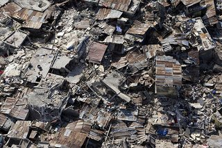 An aerial view of an impoverished neighbourhood in Port-au-Prince demonstrates the extent of damage inflicted by the powerful earthquake that rocked the Haitian capital on 12 January.<br><br>13/Jan/2010. Port-au-Prince, Haiti. UN Photo/Logan Abassi. www.un.org/av/photo/