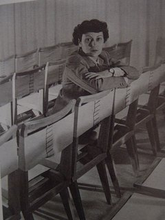 The architect with her side chair designs, year unknown. Photo courtesy Espasso.