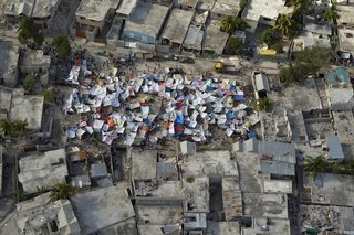 Haitians set up impromtu tent cities thorough the capital after an earthquake measuring 7 plus on the Richter scale rocked Port au Prince, Haiti, just before 5 pm on January 12, 2009.