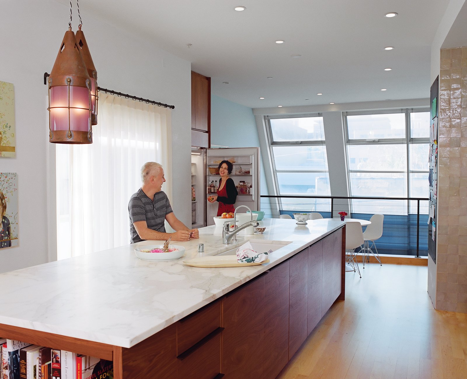 Vintage pendants cast a soft glow over the island, which contains a Bosch dishwasher.  Photo 3 of 14 in Project Runaway
