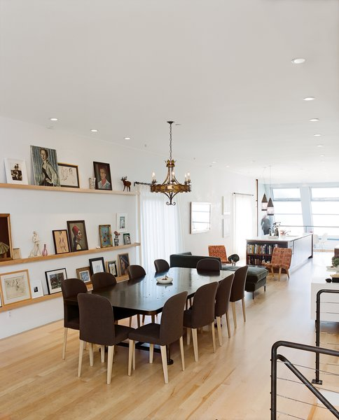 """Molteni dining chairs are overseen by """"someone's"""" ancestral portraits.  Photo 6 of 14 in Project Runaway"""