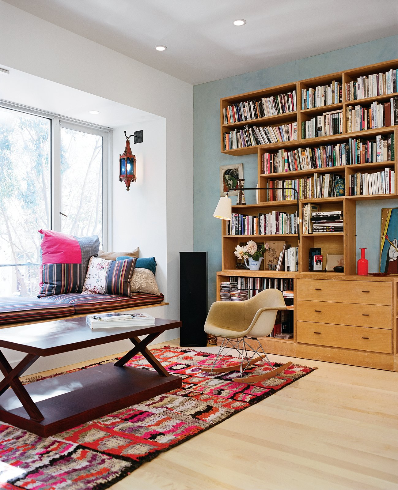 The living room is a mélange of vintage Moroccana, a Philip Agee coffee table, the Eames rocker in which Michael was nursed as a tike, and a window seat whose fabric is Paul Smith Stripes for Maharam.  Photo 7 of 14 in Project Runaway