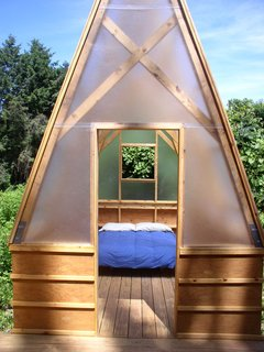 """The Swamp Hut comfortably sleeps four in the two sleeping huts. """"It's glorified camping,"""" Moskow says, however, they follow standard backpacking rules of """"pack in, pack out,"""" bringing with them their own supply of water and nonperishable foods and carrying out their trash at the end of a trip. There's a composting toilet, """"but it's easier to go in the woods,"""" he adds."""