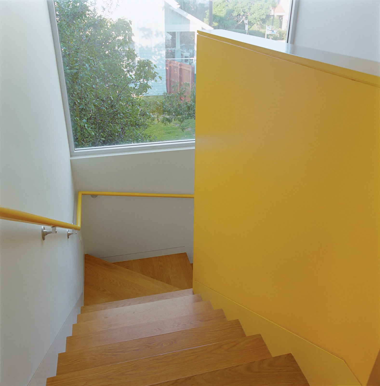 Bestor gave each area of the house its own color scheme. The bright yellow stairwell maintains a cheery mood throughout.  Photo 6 of 11 in Daft Punk Could Play at This House
