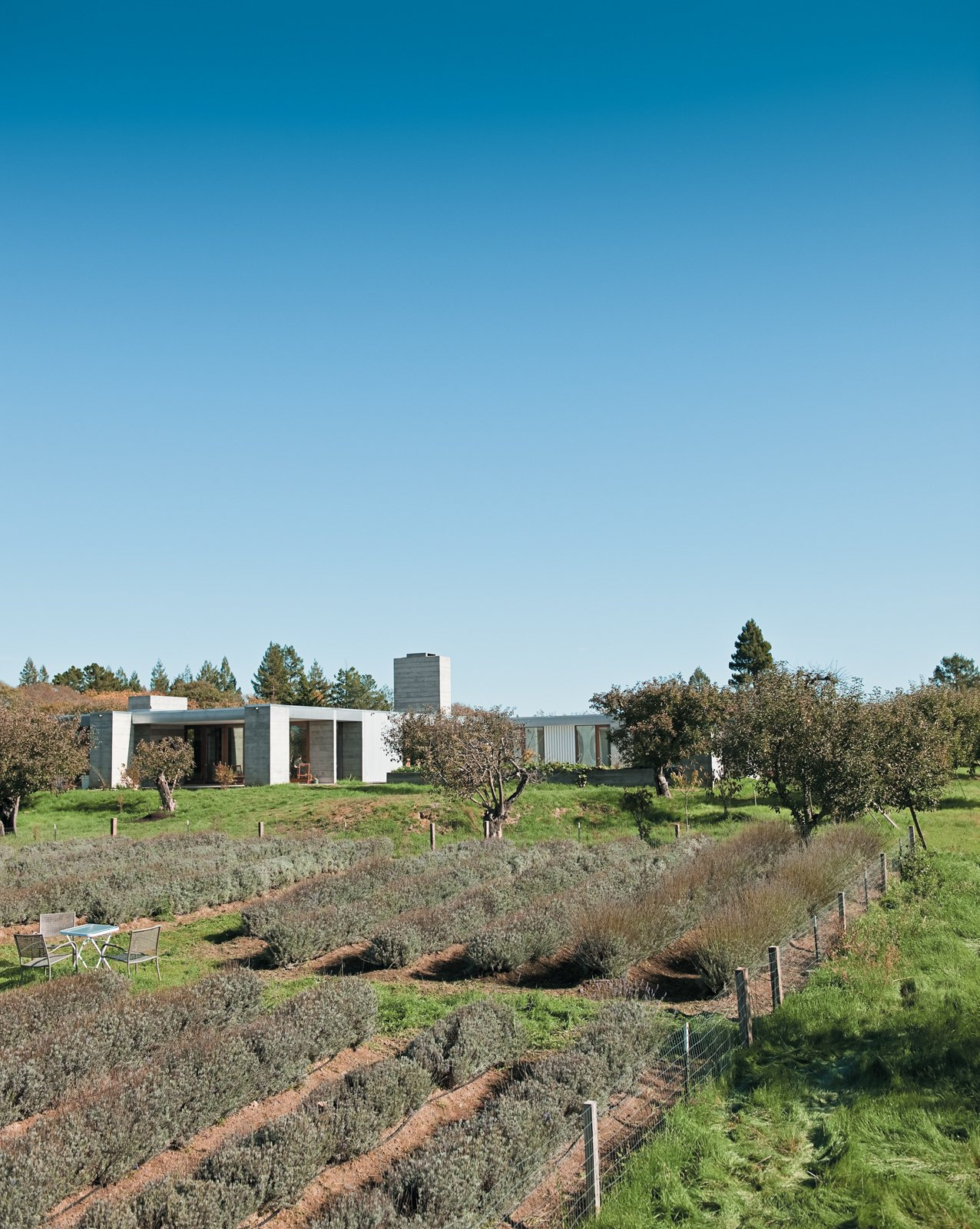 Exterior, Flat RoofLine, Concrete Siding Material, and House Building Type The Hupert-Kinmont house lies low in a century-old apple orchard, far from neighboring houses. The spaciousness of the rural surroundings is echoed inside.  Photo 2 of 23 in Fertile Grounds