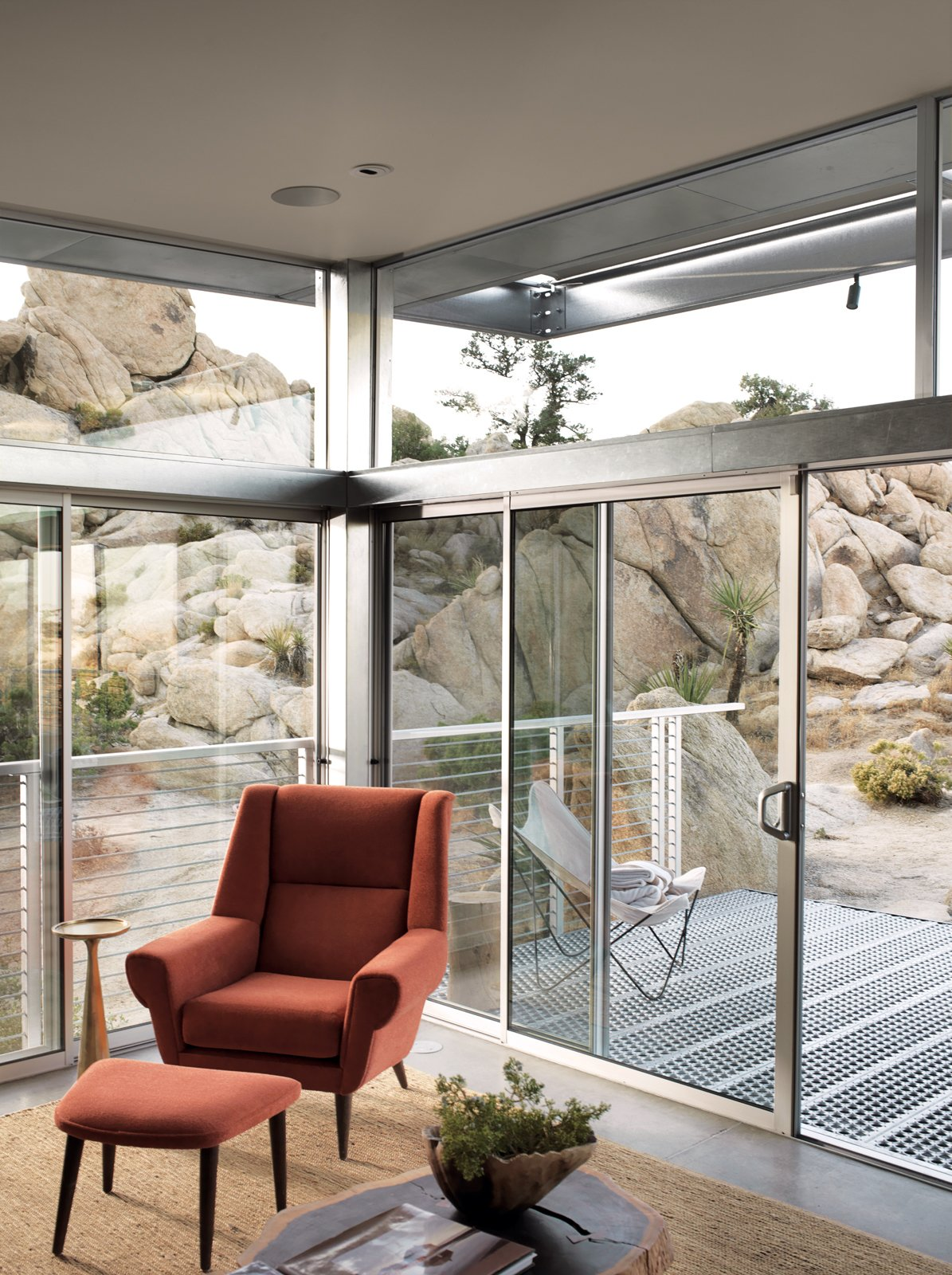 """The main living area extends to the deck through sliding glass doors.  Photo 6 of 10 in Small """"Hybrid Prefab"""" Home in the Desert"""