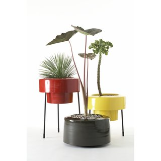 You don't get much more mid-century-modern than the Pod from Pad Outdoor—and once you see these, you'll want many more than just one. The aluminum planter, finished with an exterior-grade powder coating, comes as a half skirt (shown) and full skirt and can be placed directly on the ground or atop a 15-inch or 22-inch (shown) stand. Available in white, red, orange, brown, gold, and seafoam.