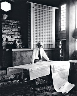 """When I set up this shot of Wright in his studio at Taliesin, he hadn't shaved that morning and told me he wasn't about to. So I had to move the camera back to conceal the stubble, which actually improved the shot."" Behind Wright is a model of the San Francisco Call building, a favorite of his that was never built."