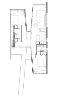 """The architect designed the building in an X formation, with two main modular structures united by a passageway. The living and sleeping areas were placed at opposite ends of the space to allow for privacy and """"to allow the children to continue their autonomous relationship with their parents on their way to self-reliance,"""" he notes."""
