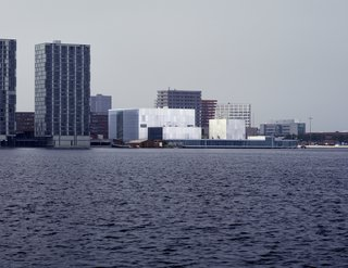 2010 Pritzker: Sejima and Nishizawa - Photo 2 of 10 - Boxy and defined by just a bit of chromatic variation, the facade of the De Kunstlinie Theater and Cultural Center in Almere, the Netherlands, looks out on the sea.