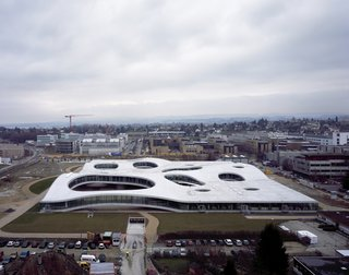 2010 Pritzker: Sejima and Nishizawa - Photo 5 of 10 - Here is the undulating, topographical form of the Rolex Learning Center in Lausanne, Switzerland. The building opened in 2009 and is the latest addition to the Ecole Polytechnique Federale de Lausanne.