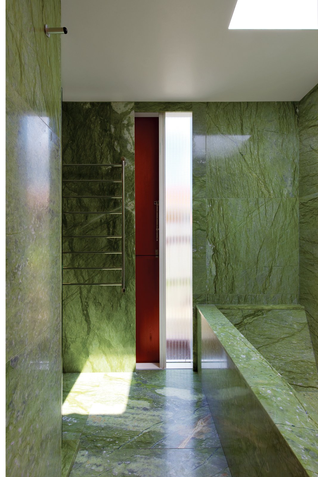 Bath Room, Marble Floor, Marble Wall, and Drop In Tub The tiny budget still allowed room for some strategic splurges, such as the vivid green Verde Ming marble in the house's only bathroom  Photo 9 of 11 in The Great Compression
