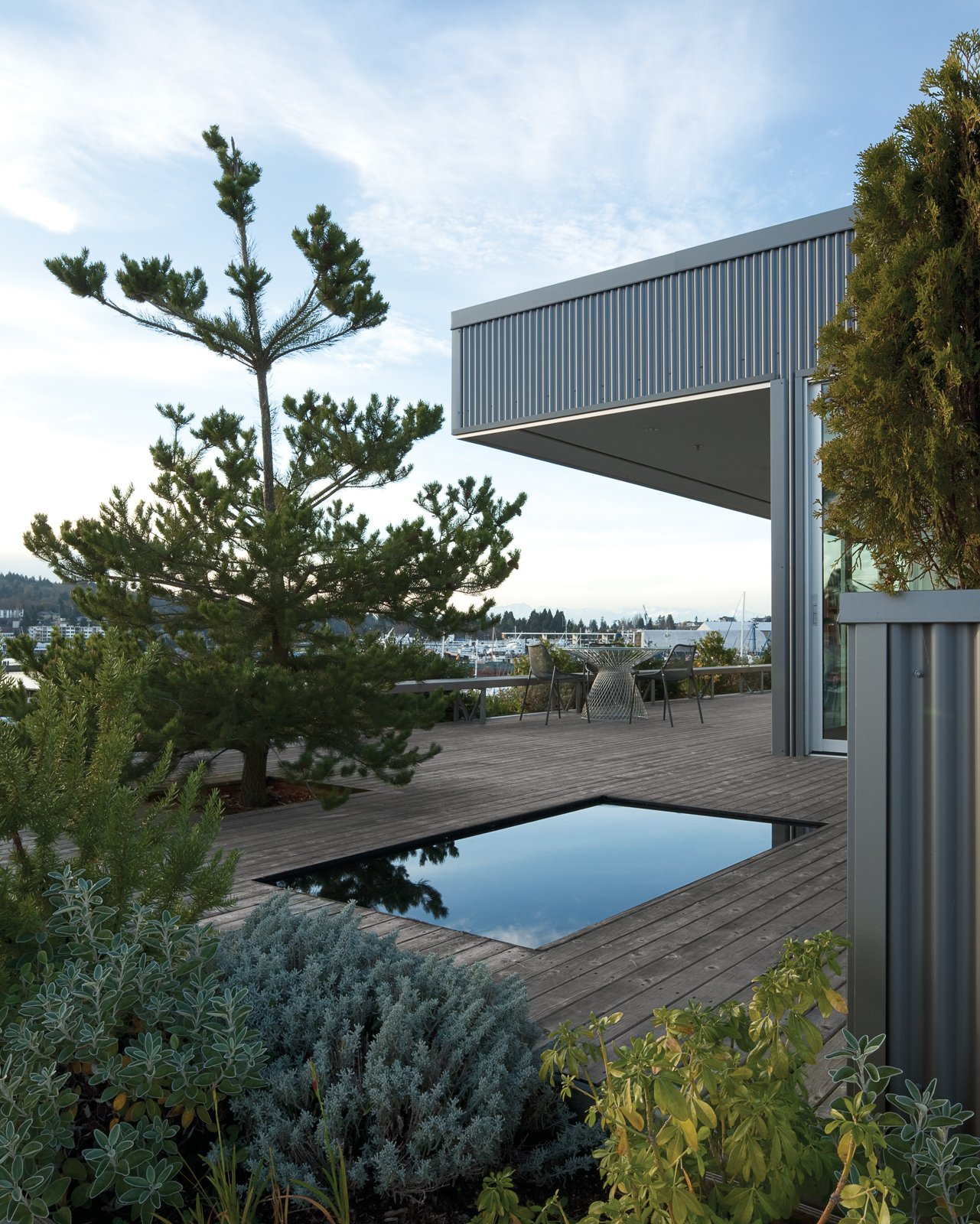 Outdoor, Large Patio, Porch, Deck, Small Pools, Tubs, Shower, Wood Patio, Porch, Deck, and Trees The reflecting pool is surrounded by foliage and breathtaking views of the bay.  Photo 10 of 10 in Sky Small