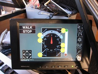 Created with the use of Processing, this is the touchscreen interface with which you can independently control the position of each leg.  As you can see, you can tell it which direction you want it to walk, and how much to turn left or right (with three legs on the ground at all times for stability, moving at a maximum speed of 60 meters per hour).