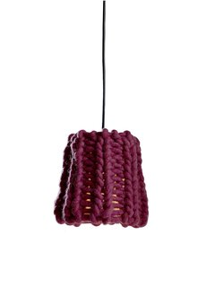 There were actually a handful of yarn lampshades at the fair—the others I saw were from Mut and Ana Krâs at the Salone Satellite—which, as a novice knitter and fan-of-craft, I loved. Granny, a chunky burgundy pendant by Pudelkern Design for Casamania, was inspired by cold winters in the Alps, and made from fire retardant wool.