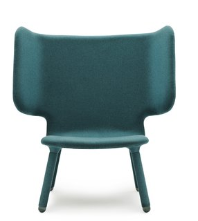 "The ""wings"" on Valdemar, this new upholstered chair from industrial designers Martin Kechayas and Christian Nørgaard for Normann Copenhagen, make sitting into a blissfully solitary pleasure. The upholstery covers the legs, too, giving a complete color block look, and it's comfy, too; You can lean to either side and settle in with a book and forget about the rest of the room."