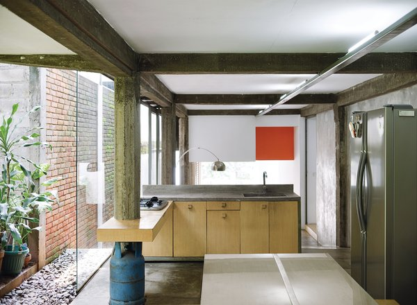 A kitchen that opens onto the garden is the complete antithesis of Jakarta's often dim and dingy suburban interiors.