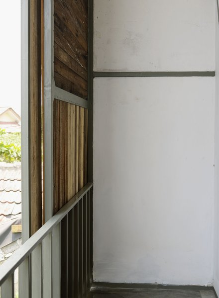 Here's a look at the other side of the sliding panel on the street-facing facade. The materials of the house were sourced locally so a good bit of Indonesian timber went into the house.