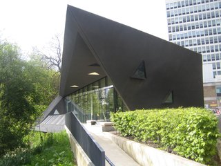 Zaha Hadid's first built project in the United Kingdom was her 2006 design for a Maggie's Center in Kirkcaldy in Fife. There are a serveral Maggie's Centers across the United Kingdom and they offer emotional, spiritual, and psychological aid to those diagnosed with cancer and their families.