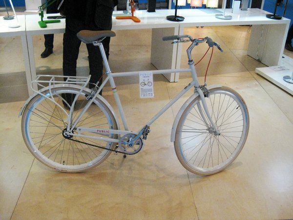 """Back on the floor of the ICFF, PUBLIC bikes made cameos in a select number of booths. Here's a white Public D with a rear bicycle rack. The frame is a classic """"double diamond."""""""