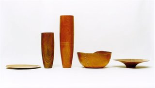 An array of Carmona designs, including the Fino tray and vases, the Governador bowl and the Shallow Fruit Bowl, all made from fallen Brazilian trees and some stitched with natural fiber.