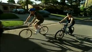 In a still from the show Living with Ed, Begley takes a fan on a bike ride.