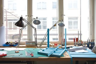 An advanced mock-up for the stackable outdoor chair he's designing for Piazza San Marco in Venice sits on a workstation.