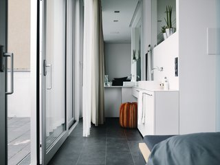The bedroom and bathroom make up the private zones on the top floor.