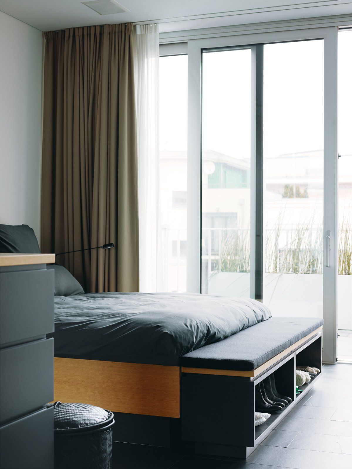 Bedroom and Bed The interior is bright and charming, cool but not cold. Each floor is open, with an unencumbered view from the glass facade in front to the glass doors in back, which makes the rooms feel much larger than they are.  Photo 15 of 16 in A Rational Approach