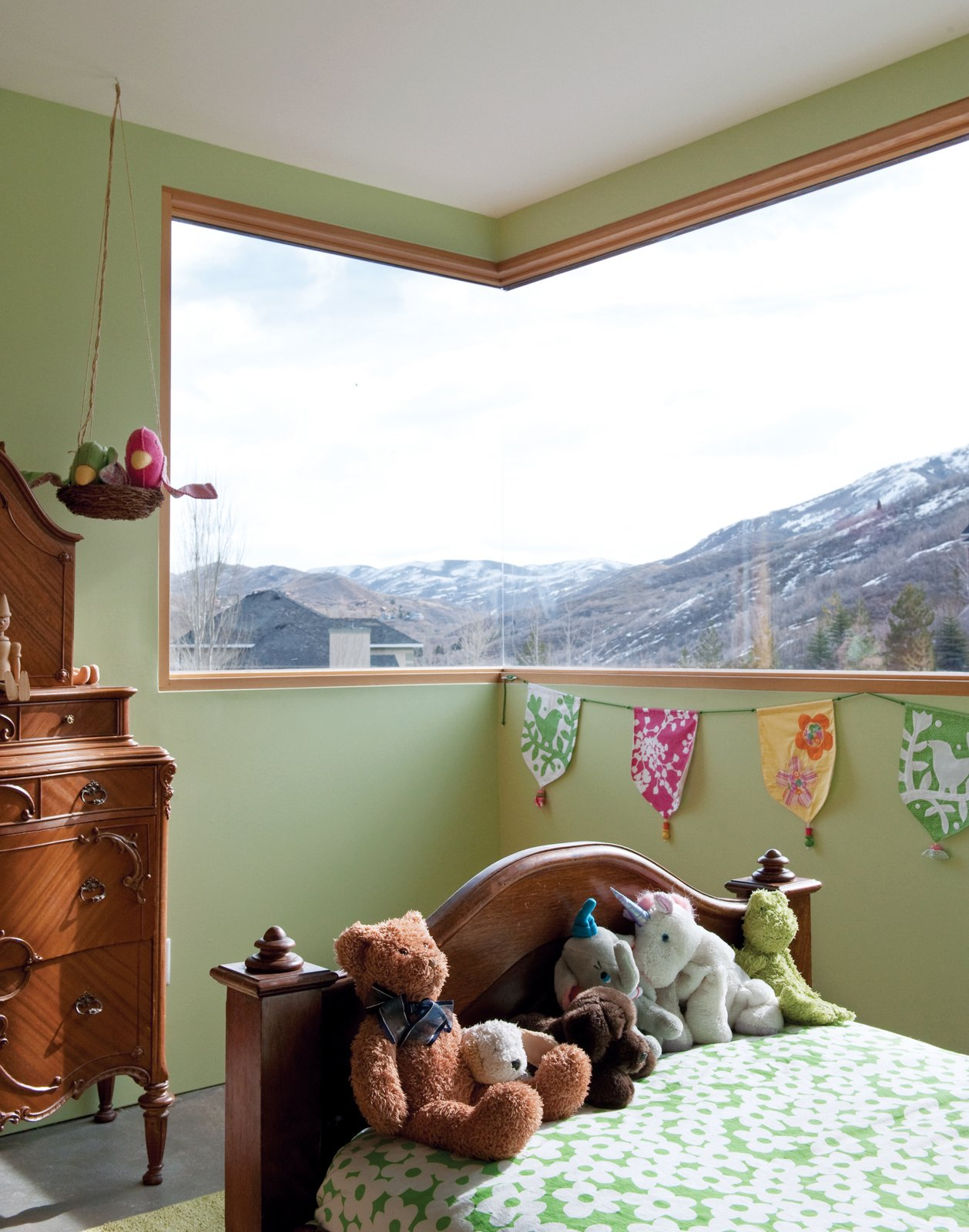 The antique cherry wood furniture in Claire's room once outfitted Mooney's childhood bedroom.  Photo 7 of 10 in The First LEED for Homes–Rated House in Utah