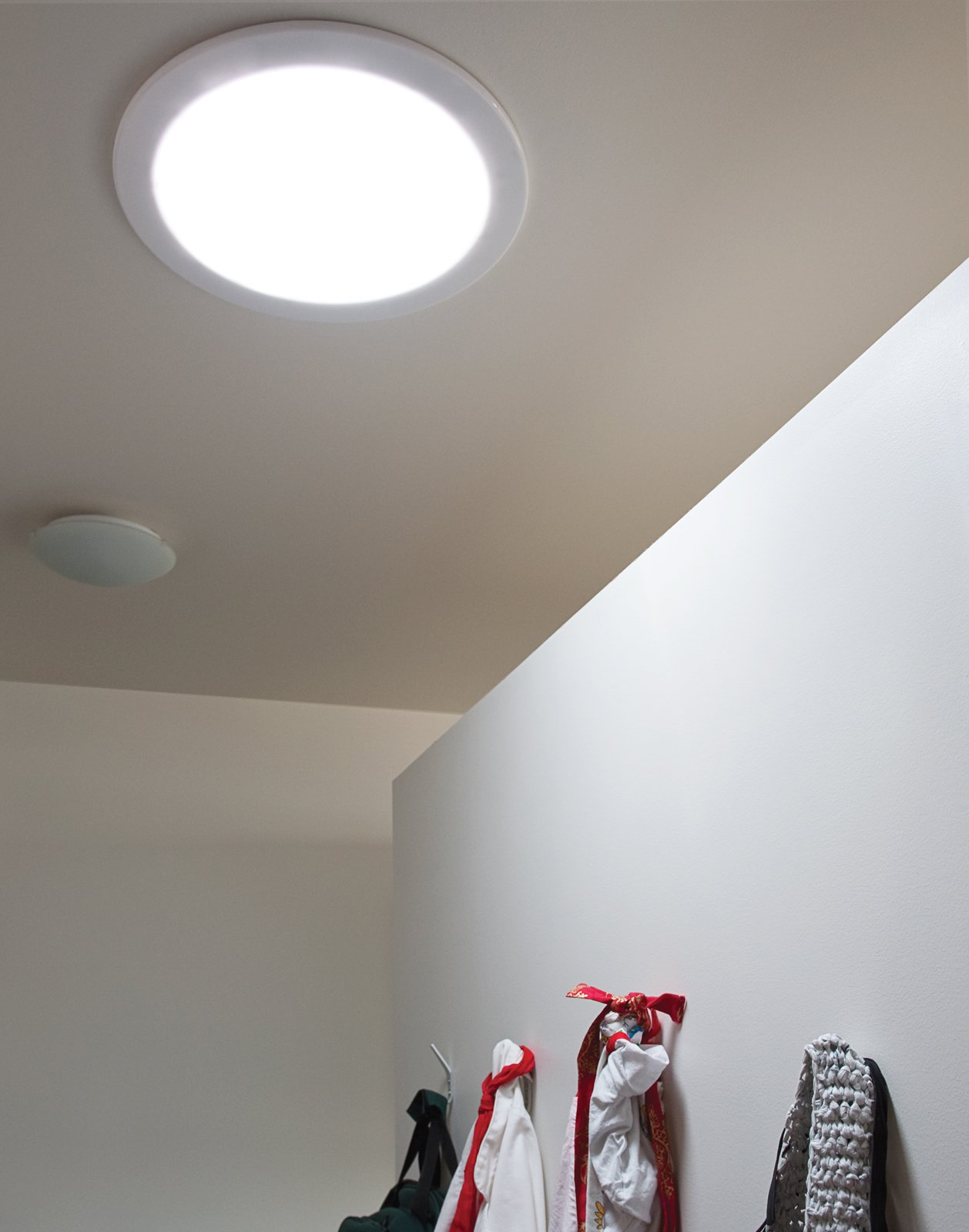 To draw light into windowless interior rooms, Mooney and Sparano installed Solatube Daylighting Systems.  Photo 9 of 10 in The First LEED for Homes–Rated House in Utah