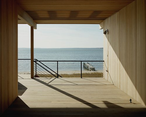 """Looking out to the water, the view peers back to Long Island with the Left Fork on its right, and the Right Fork just opposite. """"It's like a huge harbor with its outstretched arms around you,"""" Tamarkin says. Courtesy Architects and Artisans.  Shelter Island Retreat by J. Michael Welton"""