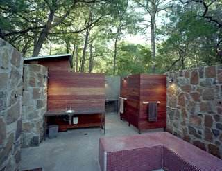 With its Brazilian Tigerwood enclosures, the outdoor bathhouse, which includes showers, sinks and dressing areas, references the nearby bunkhouse.
