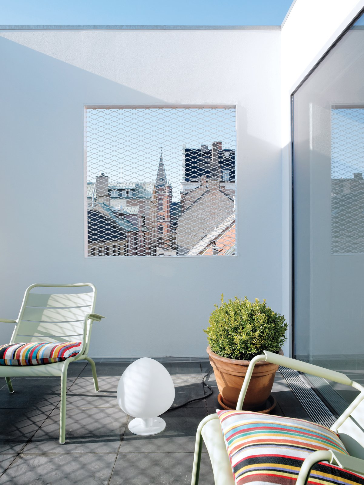 "Outdoor and Rooftop The roof terrace offers a view of the town square, ""filtered"" through a grille.  Photo 13 of 14 in Contemporary Nordic Town House"