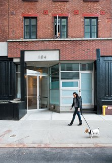 A SoHo side street is home to the second-floor loft. Once a horse stable, then a hardware store, the building dates  back to the 19th century, a relic from the neighborhood's less chic past.