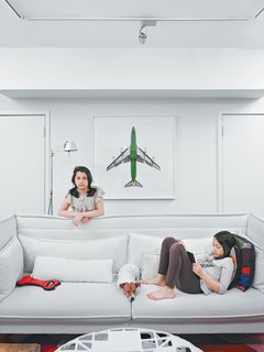 A photo from Jeffrey Milstein's Aircraft series hovers behind the Alcove sofa (which is terrier Leica's favorite place to sit) by Ronan and Erwan Bouroullec for Vitra.