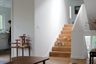 """""""To maintain the seamless connection from room to room, it was important that the flooring material was the same throughout the house,"""" Waechter says. """"We took that continuity down to the smallest detail, eliminating the nosing so the treads look like a folded floor rather than a stair made up of treads and risers."""""""