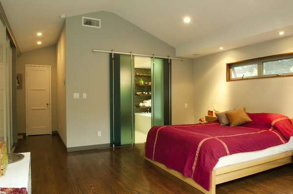 bedroom with sliding glass doors on rail