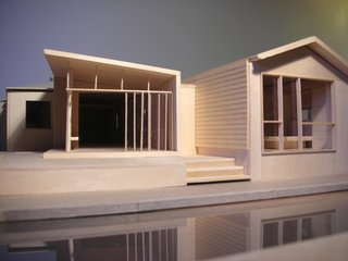"""Misra and Pande created a tiny wood three-dimensional model of the addition, showing the relationship between the separate elements. At far left is the existing kitchen, and the jog between the two portions of the addition represents a pause between the new spaces. """"We went thru a fair number of architectural models before we all decided upon this specific configuration,"""" says Pande. Image courtesy Chinmaya + Apurva: Collaborative"""