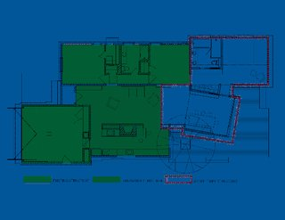 """The floor plan reveals the existing house, in green, and the addition, bordered in red. The angle of the lantern """"was a pretty intentional shift on our part,"""" says Misra. """"First we had it parallel to the barn on plan, but we tweaked it a little and gave it an angle, because when standing on the patio and looking out to the pool, the sightline is best this way. In a parallel format, the patio and pool felt a little close, and this way we were able to maximize the spacious feeling by playing with the angles slightly."""" Image courtesy Chinmaya + Apurva: Collaborative"""