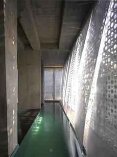 A Modern Aesthetic in Mumbai - Photo 14 of 17 - The pull-down scrims over the lap pool move with the breeze within the public space.