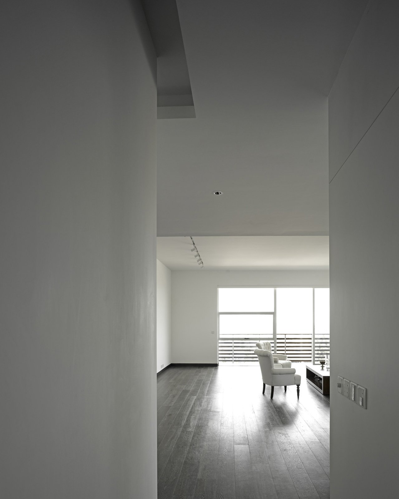 The owner's apartment, which incorporates a double-height space in some areas, has teak floors, whereas the other units have more industrial concrete floors.  Photo 15 of 17 in A Modern Aesthetic in Mumbai