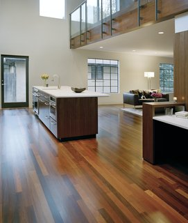 Alter and the residents chose to utilize ipe, an ultra-durable Brazilian hardwood, for the interior flooring and second-story exterior paneling. The wood, so dense that it must be drilled and screwed rather than nailed, often comes in an unpredictable array of color shades, evident in the floor's natural pattern.