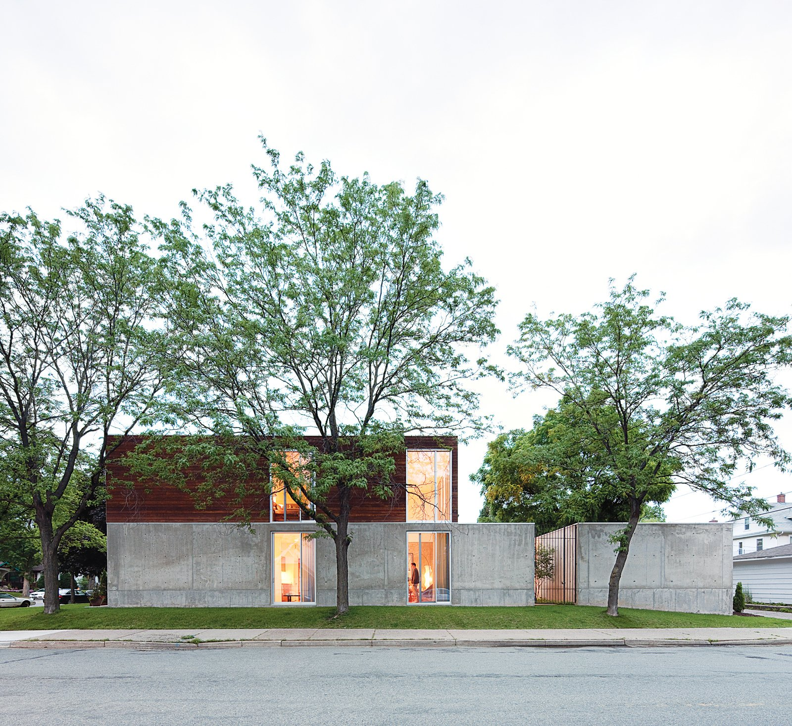 """The home's mix of dark ipe wood, concrete, and glass give credence to Winter's description of it as """"an open bunker.""""  Photo 5 of 29 in Modern Urban Retreat in South Minneapolis"""