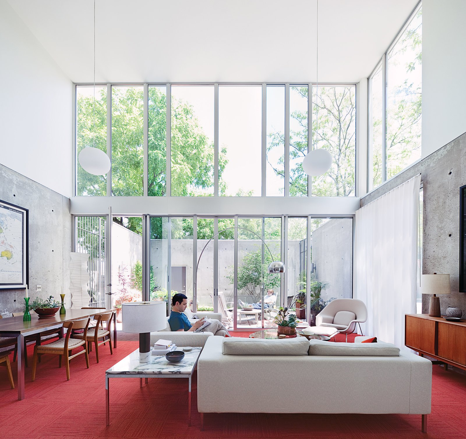Living Room and Sofa A loveseat and two Neo arm chairs by Niels Bendtsen in the living room offer Blauvelt a light-filled view to the courtyard beyond.  Photo 6 of 29 in Modern Urban Retreat in South Minneapolis