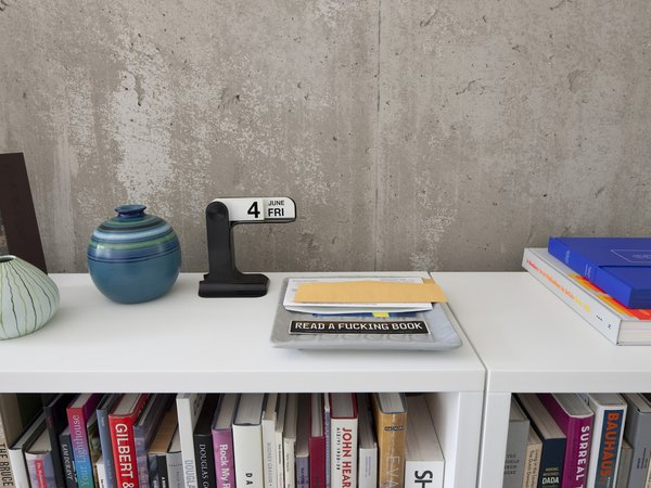 Design tomes, a salient message, mid-century ceramic.  Photo 17 of 29 in Modern Urban Retreat in South Minneapolis